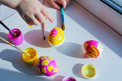 Coloring Easter eggs with children. joint creativity, developing classes. the view from the top stock images
