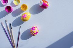 Coloring Easter eggs with children. joint creativity, developing classes. the view from the top stock image