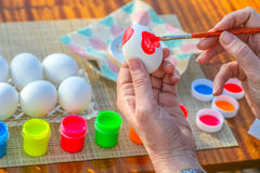 Coloring Easter eggs Stock Photos