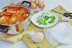 Coloring Easter eggs. With onion skin and leaves. Natural dye Stock Photography