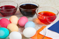 Coloring eggs for Easter Stock Images