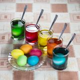 Coloring eggs for Easter holiday. Coloring eggs in bright colors for Easter holiday Royalty Free Stock Photos