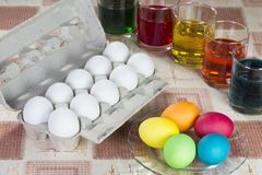 Coloring eggs for Easter holiday. Coloring eggs in bright colors for Easter holiday Stock Photos