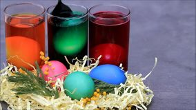 Coloring eggs for easter stock video footage