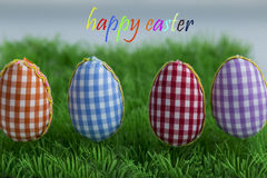 Coloring eggs, painted, blue background, green, yellow, red, orange, colored, Royalty Free Stock Image