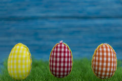 Coloring eggs, painted, blue background, green, yellow, red, orange, colored, Royalty Free Stock Photography