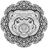 Coloring page for adults. Stern Wolverine on a background of a circular mandala pattern. Royalty Free Stock Photo