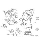 Coloring Page Outline Of cartoon boy feeding birds. Bird feeder. Royalty Free Stock Image