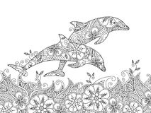 Coloring page with pair of jumping dolphins in the sea. Royalty Free Stock Image
