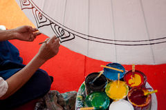 Coloring paints umbrella made ​​of paper / fabric. Arts and Stock Photography