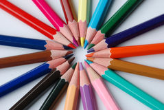 Coloring pencil background. Abstract background of coloring pencils arranged in circular shape royalty free stock image