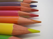 Coloring pencil crayons on a white paper. Close up Royalty Free Stock Photography