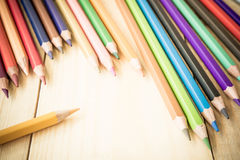 Coloring Pencil Different From The Crowd Stepping Up Royalty Free Stock Photo