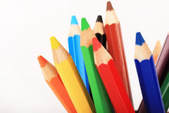 Coloring pencils. Ends of colorful sharpened coloring pencils, isolated on white background Stock Photo
