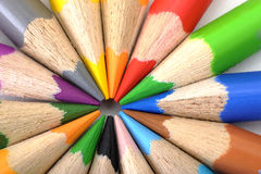 Coloring pencils. Macro view of wooden coloring pencils in different colours arranged with sharp points touching Royalty Free Stock Photo