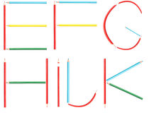 Coloring Pencils Alphabet Letters Set E-K. Isolated On White royalty free stock photo