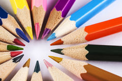 Coloring pencils. In a circle centered top view close-up shot on a white background royalty free stock photography