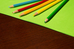 Coloring Pencils on Colored Paper Royalty Free Stock Photography