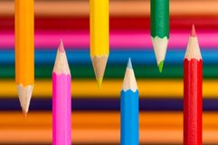 Coloring pencils on multicolored background Royalty Free Stock Photos