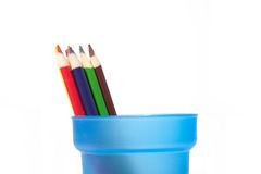 Coloring pencils to side of cup. Royalty Free Stock Image