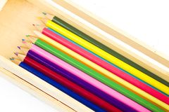 Coloring pencils in a wooden box Royalty Free Stock Image