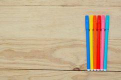 Coloring in pens on a wooden background Royalty Free Stock Images