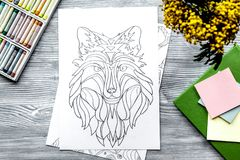 Coloring picture for adults on wooden background top view Stock Image