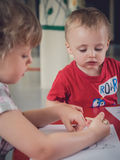 Coloring pictures. Little kids coloring pictures during art time at the nursery Royalty Free Stock Images