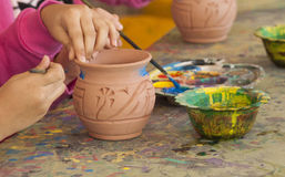 Coloring a Pottery Vase Royalty Free Stock Images