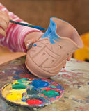 Coloring a Pottery Vase Stock Photography