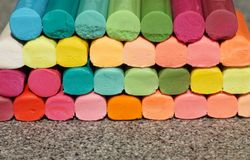 Coloring waxy pencil sticks in many different colors stacked up royalty free stock photo