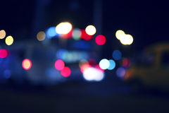 Colorized blurred street and car lights, urban abstract night time background Royalty Free Stock Images