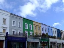 Colorized buildings street. Street in London with row of buildings in different colors stock photography