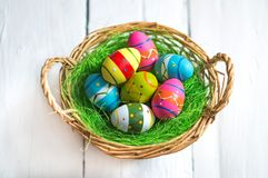 Easter eggs in wicker basket Royalty Free Stock Image
