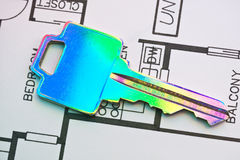 Colorized house keys against blueprints Royalty Free Stock Photography