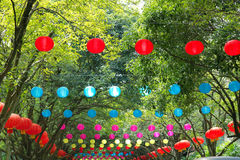 Colorized lanterns. The colorized lanterns hang on the trees stock photo