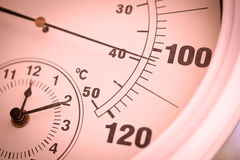 Colorized Round Thermometer Over 100 Degrees. Colorized Round Outdoor Thermometer Showing Over 100 Degrees royalty free stock photography