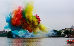Colorized smoke shapes on the surface of the lake. Stock Images