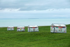 Colorized tents. The colorized tents at lakeshore of Qinghai Lake in China stock photo