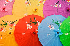 Colorized umbrella. Many colorized  paper characteristics umbrella Royalty Free Stock Photography
