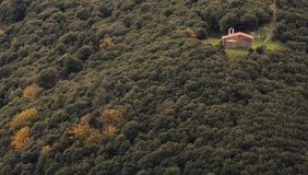 Ermita Sant Elies.The colors of Autumn appear on the mountain, corollarizing it. The colors of Autumn appear on the mountain, corollarizing it Stock Images