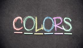 Colors background written in chalk. On a chalkboard stock photography
