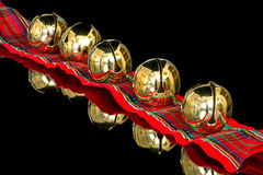 Colors of Christmas and gold bells Stock Photo