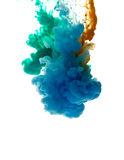 Colors dropped into liquid and photographed while in motion. Clo Royalty Free Stock Photos