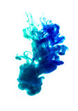 Colors dropped into liquid and photographed while in motion. Clo Royalty Free Stock Photography
