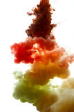 Colors dropped into liquid and photographed while in motion. Clo Stock Photos
