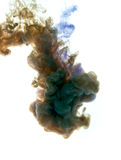 Colors dropped into liquid and photographed while in motion. Clo Royalty Free Stock Images
