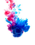 Colors dropped into liquid and photographed while in motion. Clo Royalty Free Stock Image