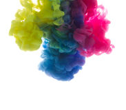 Colors dropped into liquid and photographed while in motion. Ink shape or swirling in water for design or decorate background or a. Bstract banner on white Royalty Free Stock Photos