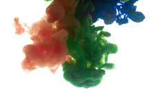 Colors dropped into liquid and photographed while in motion. Ink shape or swirling in water for design or decorate background or a Stock Photo